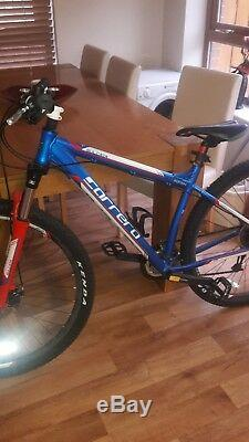 Limited edition carrera bike red, whit and blue excellent condition